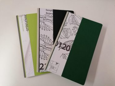 notebooks from recycled exhibition posters